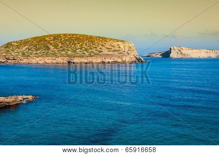 Beautiful Island And Turquoise Waters In Cala Conta, Ibiza Spain