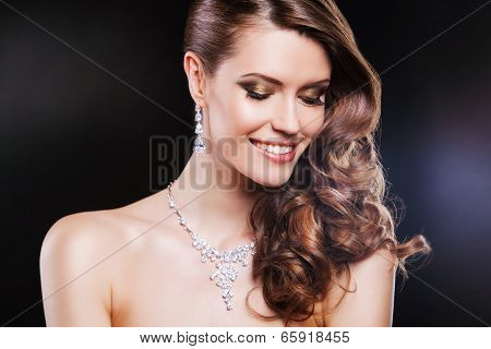 close up beauty portrait of happy brunette woman with luxury accessories.
