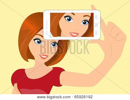 Red haired girl is taking a selfie