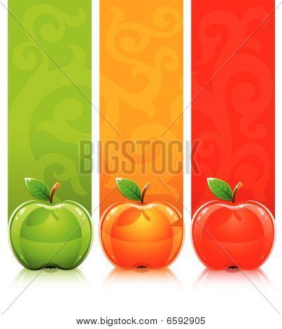 Drei farbige Äpfel auf dekorativen Hintergrund