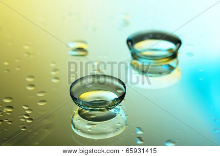 contact lenses, on yellow-blue background