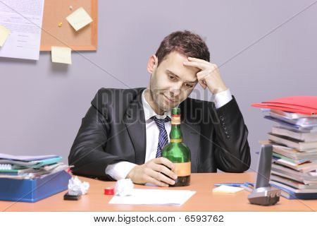 A drunk businessman in the office