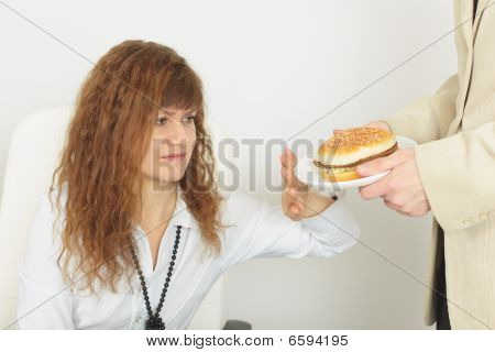 Young Beautiful Woman Refuses Harmful Food