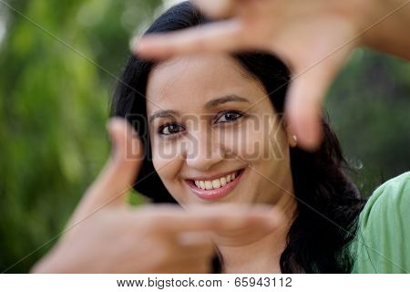 Woman Making Frame With Her Hands