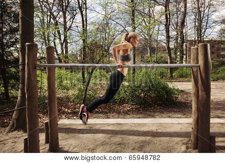 Young Woman Doing Parallel Bar Dips