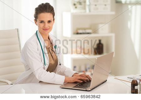 Medical Doctor Woman Working On Laptop