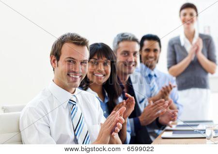 International Business Partners Applauding A Good Presentation