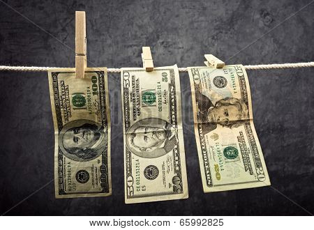 American Dollars Hanging On Rope