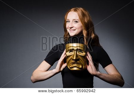 Redhead woman iwith mask in hypocrisy consept against grey background poster