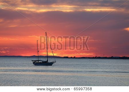 Sailing boat on the sea in twilight