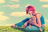 Beautiful young woman with her pit bull mix dog poster
