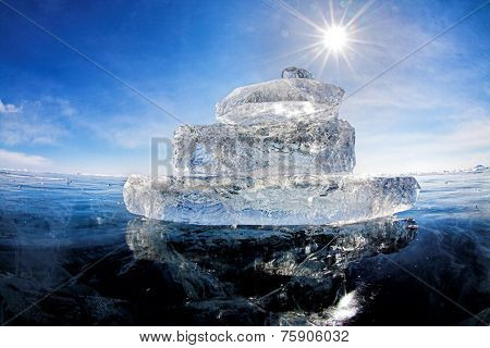 Boat made of ice on winter lake Baikal