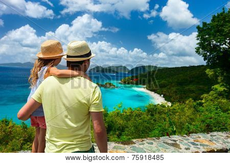 Family of father and daughter enjoying aerial view of picturesque Trunk bay on St John island, US Virgin Islands considered by many as most beautiful beach in Caribbean
