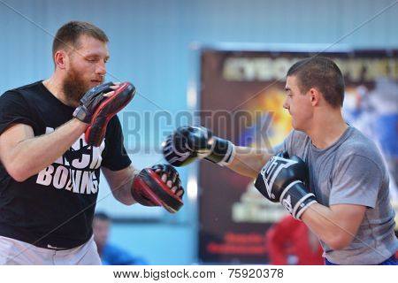 NOVOSIBIRSK, RUSSIA - OCTOBER 16, 2014: World champion in kickboxing Dmitry Antonenko (left) on the open training. The event aimed to promote the MMA Friendship Cup which took place on November 8