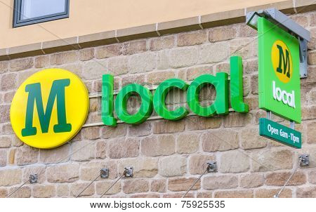 Morrisons Local convenience store sign with logo