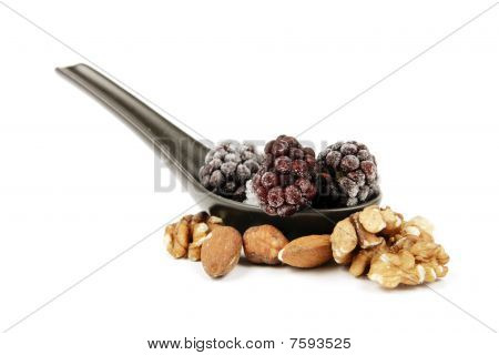 Frozen Blackberries On A Spoon With Nuts