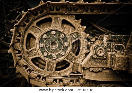 Grunge closeup view of a buldozer wheel poster