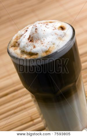 freshly poured coffee with frothy milk, focus on bubbles