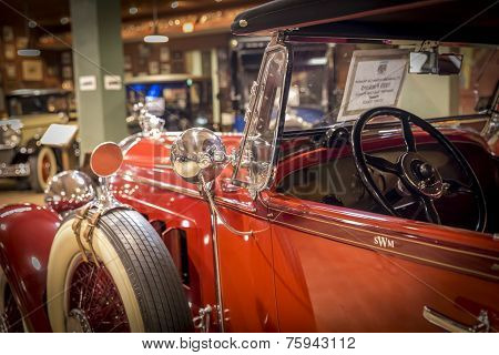 FORT LAUDERDALE FLORIDA USA - AUGUST 30: Fort Lauderdale Antique Car Museum exhibits a collection of Packard automobiles on August 30 2014 in Fort Lauderdale Florida USA. The collection includes 22 Packards in various styles and models from 1909 until 194 poster