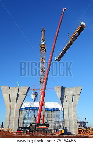 Setting Up A Tower Crane In The Construction Site.
