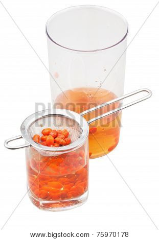 Pot And Glass With Goji Berries Infusion Isolated