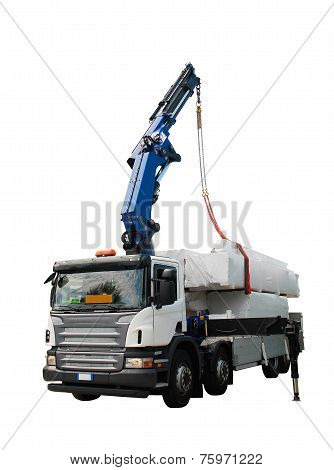 A truck with a telescopic crane delivers packages containing a wood (fir) block house a pre-cut wooden house which is assembled on-site poster