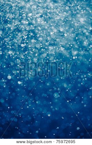 abstract blue background with bokeh particles