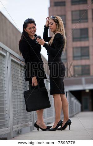 Two Attractive Hispanic Businesswomen Outdoor