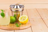 Lemon juicer with juice on wooden background closeup poster