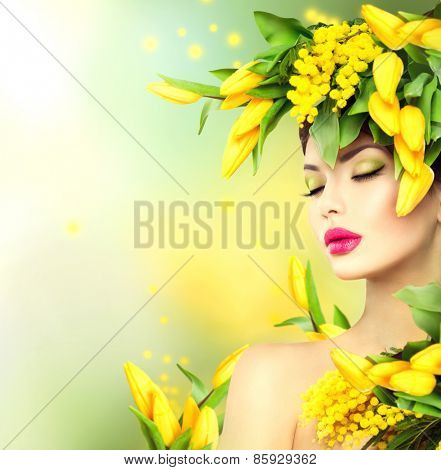 Spring woman. Beauty Spring model Girl with Flowers Hair Style. Beautiful lady with Blooming flowers on head. Nature Hairstyle. Summer. Holiday Creative Fashion Makeup. Make up. Vogue Style Portrait