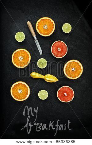 Orange And Lemon Cut On Black Stone