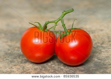 Fresh Tomatoes On Brown Background