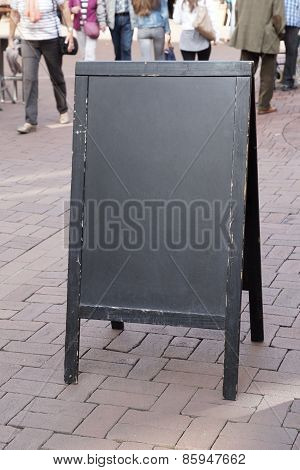 blank blackboard advertising sign in pedestrian street