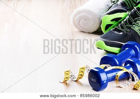 Fitness Concept With Dumbbells And Sneakers