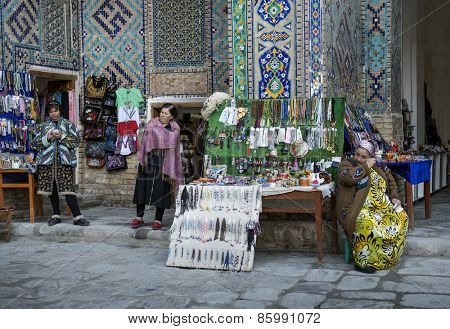 SAMARQUAND, UZBEKISTAN - MARCH 14, 2015: Registan square. Street Photography by Gift Shop. The ancient city is part of UNESCO World Heritage.