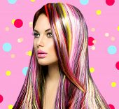 Colorful Hair and Makeup. Beauty Fashion Model Girl with Colorful Dyed Hair. Colourful Long Hair and Make up for Brown eyes. Portrait of a Beautiful Girl with Dyed Hair, professional hair Coloring  poster