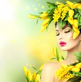 Spring woman. Beauty Spring model Girl with Flowers Hair Style. Beautiful lady with Blooming flowers on head. Nature Hairstyle. Summer. Holiday Creative Fashion Makeup. Make up. Vogue Style Portrait poster