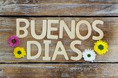 Buenos Dias (Good morning in Spanish) written with wooden letters, and Santini flowers poster