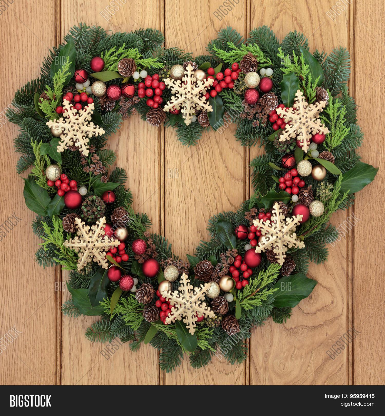 Christmas heart shaped wreath gold image photo bigstock christmas heart shaped wreath with gold snowflake bauble decorations holly mistletoe and winter greenery rubansaba