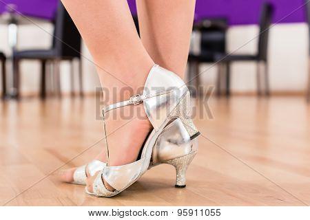 Women with her dancing shoes in dance school