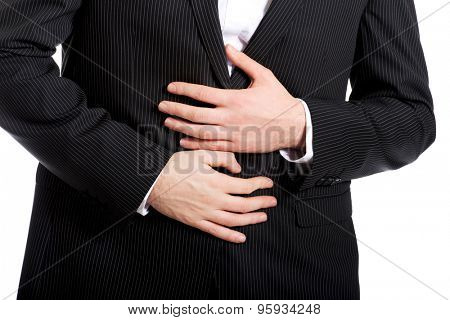 Young businessman suffering from stomach pain. poster
