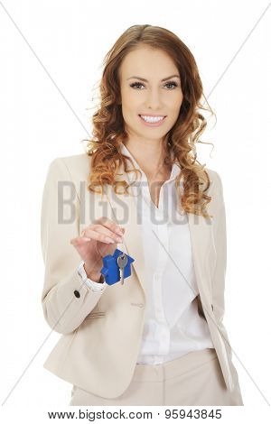 Businesswoman real estate agent giving keys.  poster