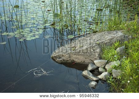 Large and small rocks by pond