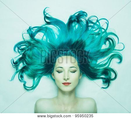 Beautiful Young Woman With Long Hair Of Turquoise Color