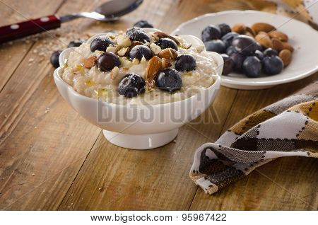 Oatmeal With Blueberries And Nuts  For  Breakfast.