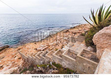 Spain coast, stairs  to sea water