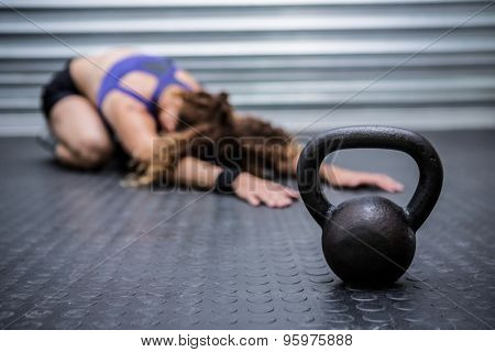 Muscular woman stretching in crossfit gym