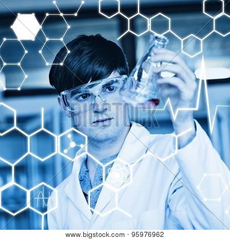 Science graphic against scientist looking at a liquid in an erlenmeyer flask
