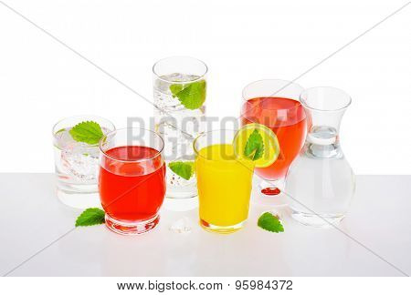 Glasses of fizzy water and fruit-flavored drinks