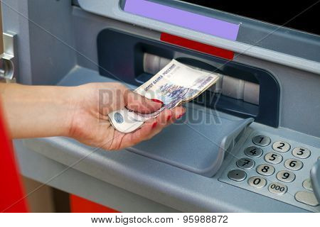 Female hands closeup with Russian rubles - woman withdraw money at cashpoints